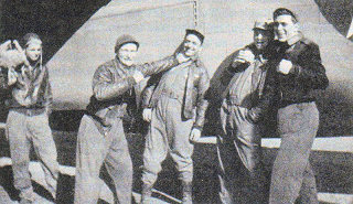 Left-to-Right: Staff Sgt. Vernon L. Moore, 2nd Lt. Lieutenant Hays, 2nd Lt. John S. Woravka, Staff Sgt. Guy E. Shelley, and Technical Sgt. Harold J. Ripslinger